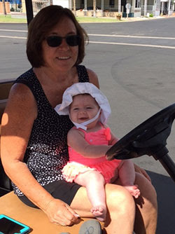Rhonda Ciacco, teaching her granddaughter about life at the park