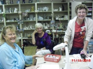 These classmates are working on a ceramic project in Room 9 Pictured are Kathleen McDowell, Teresa Carrier and Instructor Nancy Lambertson.
